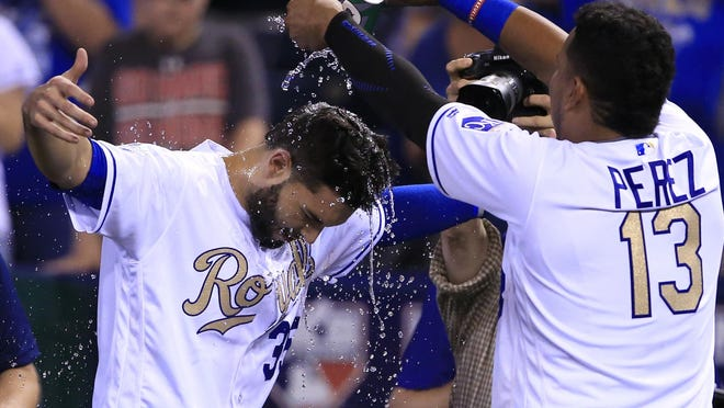 Kansas City Royals' Eric Hosmer (35) gets doused by a teammate following a baseball game against the Minnesota Twins at Kauffman Stadium in Kansas City, Mo., Saturday, Aug. 20, 2016. Hosmer drove in the winning run. The Royals defeated the Twins 5-4 in 11 innings.