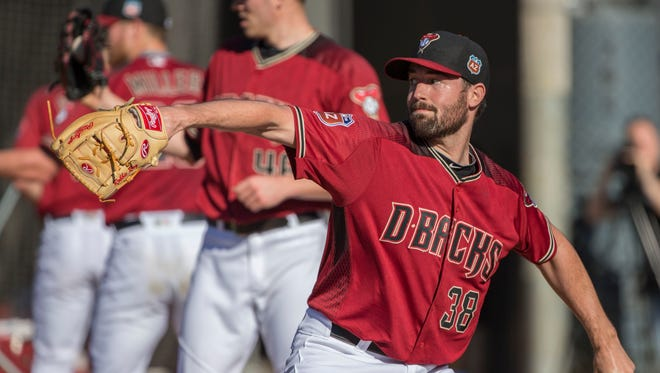 Diamondbacks' Robbie Ray pitches during spring training at Salt River Fields at Talking Stick on Sunday, February 21, 2016.