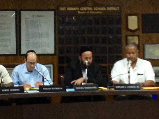 The East Ramapo Board of Education at a meeting July