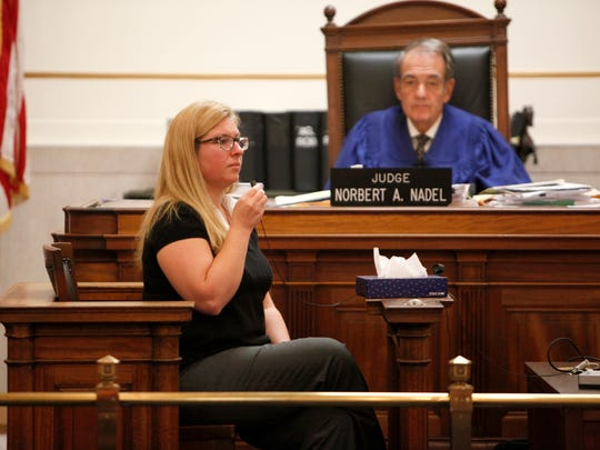 Former Colerain High teacher Julie Hautzeroeder sits on the stand during a hearing before Common Pleas Court Judge Norbert Nadel.