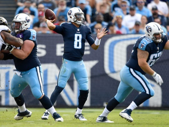 Titans quarterback Marcus Mariota (8) throws during