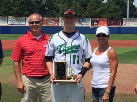 Yorktown alum Clay Dungan poses with family and his North-South All-Star MVP award.