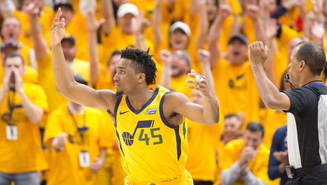 Utah Jazz guard Donovan Mitchell (45) reacts during the first quarter of game six of the first round of the 2018 NBA Playoffs against the Oklahoma City Thunder at Vivint Smart Home Arena.