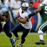 Titans running back Shonn Greene (23) looks to break through the hole against the Jets in the first quarter Sunday.