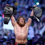 Daniel Bryan celebrates after winning the WWE title during WrestleMania 30 at the Super Dome in New Orleans on April 6, 2014.