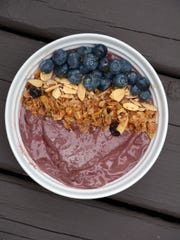The Acai Smoothie Bowl includes  frozen unsweetened acai berry pulp and toppings of blueberries, pomegranate seeds, granoia and almonds.