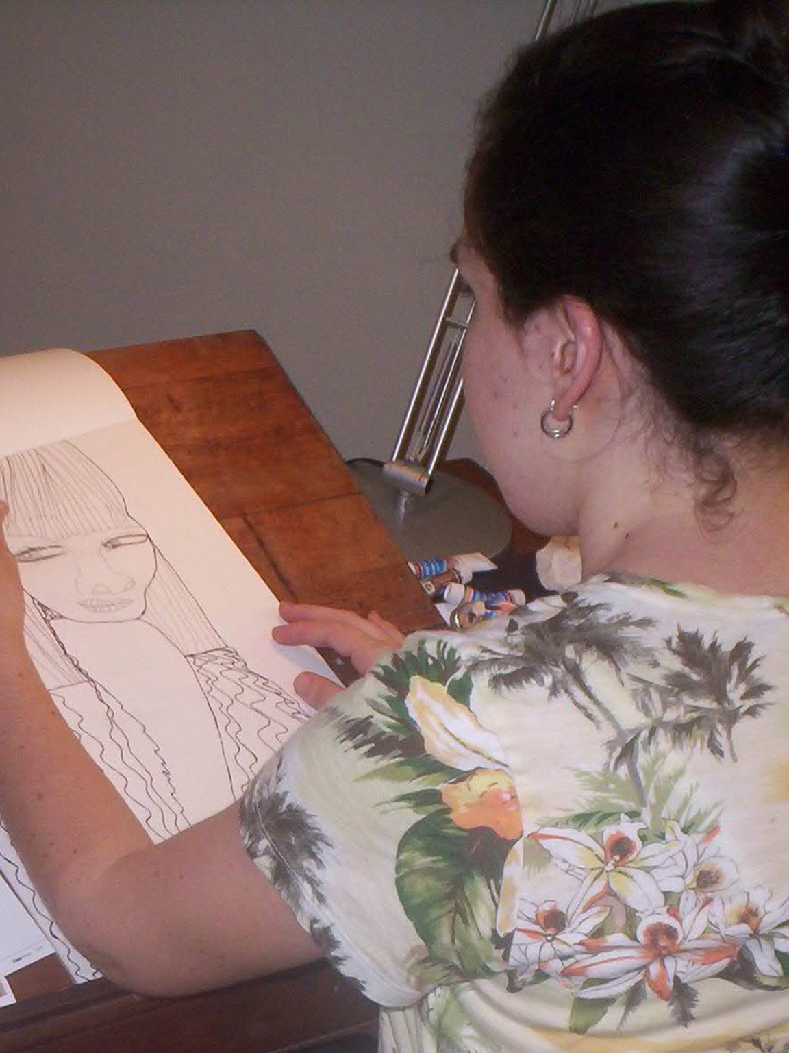 Brooke Conner sketches the outline for a painting during a trip she took in her 20's to visit her brother in Chicago.