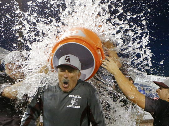 Head coach Paul Niggebrugge is doused following Caravel Academy's state baseball championship win on June 3.