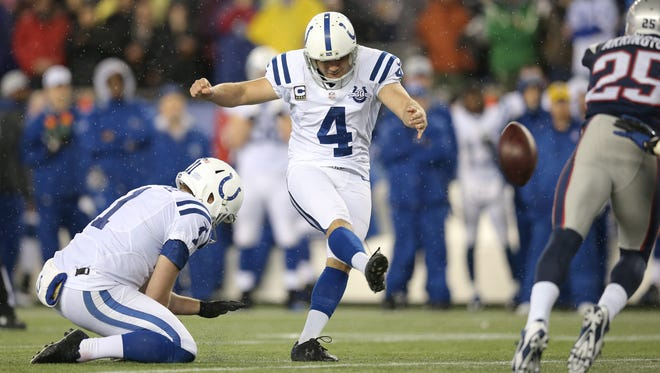 Indianapolis Colts kicker Adam Vinatieri makes the extra point during the first half of the AFC playoff game against the New England Patriots Saturday, January 11, 2014, evening at Gillette Stadium in Foxborough,MA.
