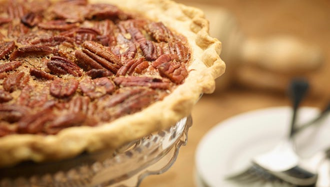 This Oct. 14, 2016, photo provided by The Culinary Institute of America shows pecan pie in Hyde Park, N.Y. This dish is from a recipe by the CIA. (Phil Mansfield/The Culinary Institute of America via AP)