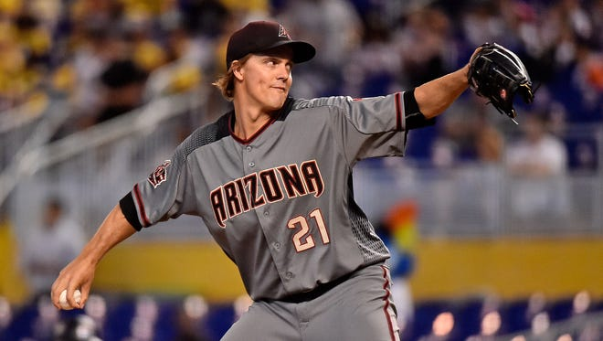 Arizona Diamondbacks starting pitcher Zack Greinke (21) delivers a pitch in the first inning against the Miami Marlins at Marlins Park