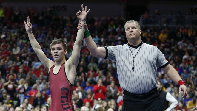 Clarion senior Josh Portillo celebrates a win over Crestwood sophomore Michael Millage at 120 pounds during the Class 2A Iowa high school wrestling championships at Wells Fargo in Des Moines.