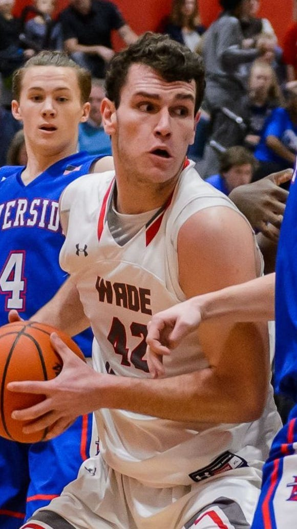 Will Edwards, center, shown in an earlier game, had 18 points and 12 rebounds and scored the winning basket for Wade Hampton in its 61-59 win over Nation Ford Friday night in their Class AAAAA third-round playoff game.