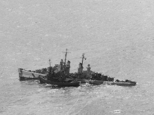 1944. The USS Zuni, front, helps in salvage operations