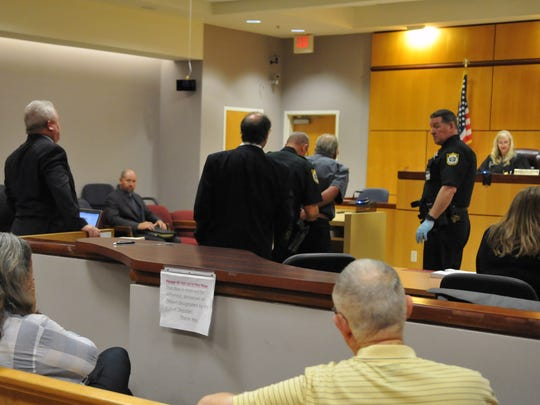 The sentencing of James and Lisa McDermott by Circuit Judge Morgan Laur Reinman in Viera. James was sentenced to over 34 months, and made it clear to the court that his wife Lisa was in no way involved in the stolen goods being sold on eBay activities that got him arrested, and he told her he loved her as he was led out of the courtroom. Lisa was then sentenced to one year probation. This photos show Lisa, seated at left, beginning to cry, as the cuffs are put on James.
