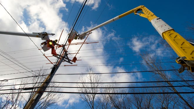 A Green Mountain Power employee at work in Essex on Jan. 20, 2012.