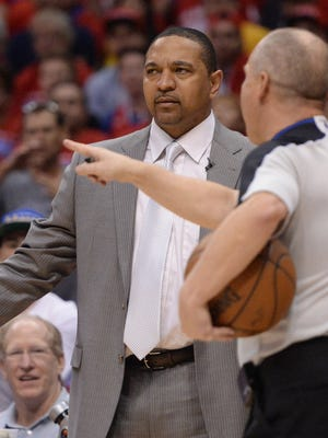 Warriors coach Mark Jackson talks with referee Ron Garretson in the first quarter of Game 1 against the Clippers, which Golden State won.