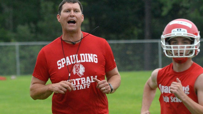 Spaulding High School football coach Kevin Hebert looks on during a 2018 football practice.