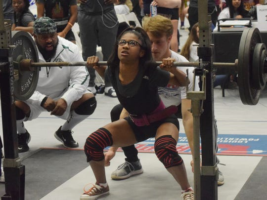 Qwenisha Hillard of Peabody Magnet High School competes in the 2018 LHSAA/LHSPLA Division I-V Powerlifting Meet held at the Rapides Parish Coliseum Friday, March 16, 2018. Hillard won in the 97-pound weight class.