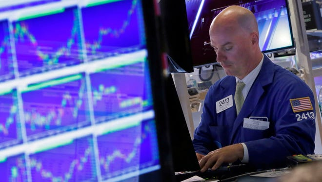 A man works at his post on the floor of the New York Stock Exchange on Aug. 26, 2015.