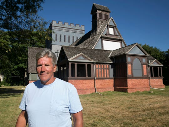 Long Branch historian Jim Foley in front of the Church of the Presidents, where seven former presidents worshiped.