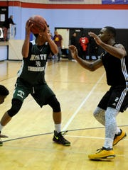 Trae Young, the fifth overall pick in the 2018 NBA draft, looks to pass while guarded by Lancaster's T.J. Starks during a game in the 2016 Elite 14 Showcase. This year's event will feature some of the nation's top recruits.