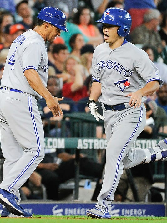 Toronto Blue Jays' Norichika Aoki, right, celebrates his two-run home run off Houston Astros starting pitcher Mike Fiers with third base coach Luis Rivera, during the seventh inning of a baseball game, Sunday, Aug. 6, 2017, in Houston. (AP Photo/Eric Christian Smith)