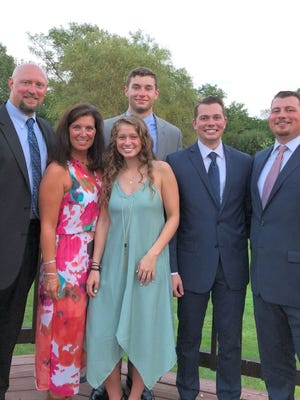 A golfing, hunting and fishing enthusiast, former Oakmont multi-sport athlete Kurt Kublbeck, far left, also enjoys spending time with his wife Jennifer, daughter Olivia, and sons Kyle, Eric and Connor.