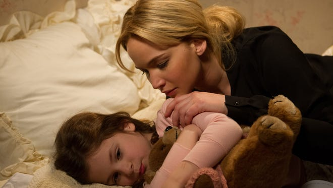 Joy (Jennifer Lawrence) comforts her daughter, Christy, in David O. Russell's 'Joy.'