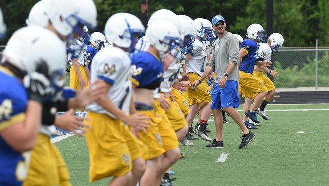 Mountain Home High School head football coach David Joyce smiles while watching his players run drills on Thursday. The annual Blue and White Scrimmage is set for 5:30 p.m. today at Bomber Stadium.