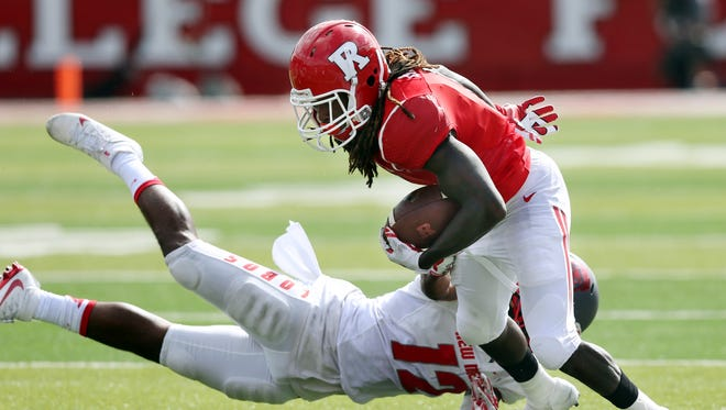 Rutgers receiver Janarion Grant had two touchdowns Saturday, including a 69-yard punt return that gave the Scarlet Knights a 28-21 lead before halftime.