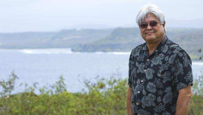 In this June 2010 file photo, John Salas, retired University of Guam international tourism professor and a former senator, poses for a photo across from UOG's Human Resources Office.