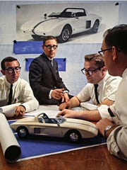 Roy Lunn, center, and his assistants with the Ford Mustang I, a predecessor to the pony car that would be introduced in 1964.