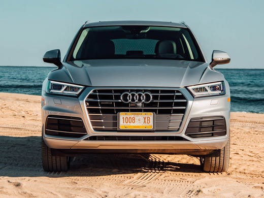 Review Audi Q SUV Fights A Battle Of Inches - Audi q5 family car