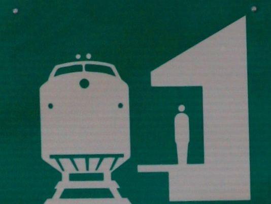 635553792606933193-1392748956016-Train-station-sign