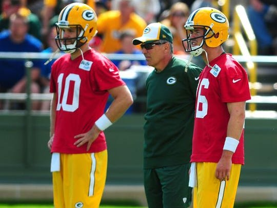 Green Bay Packers offensive coordinator Tom Clements with quarterbacks Matt Flynn, left, and Scott Tolzien, during training camp practice at Ray Nitschke Field.