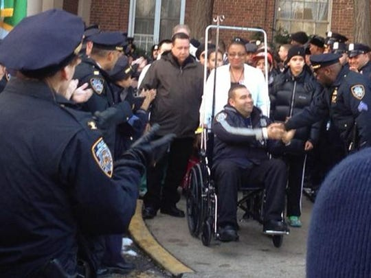 NYPD Officer Aliro Pellerano of Garnerville is released from the hospital Wednesday afternoon. (Photo: Courtesy NBC New York)