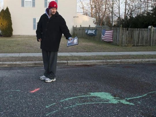 Edmond Bock III stands near the area on Aqua Lane in Waterford's Atco section where his 6-year-old son was struck Monday morning by a school bus.