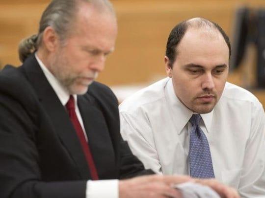 Attorney Ron Davis, left, explains the jury selection