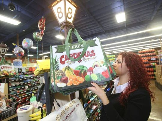 A woman shops at Cardenas in Indio.