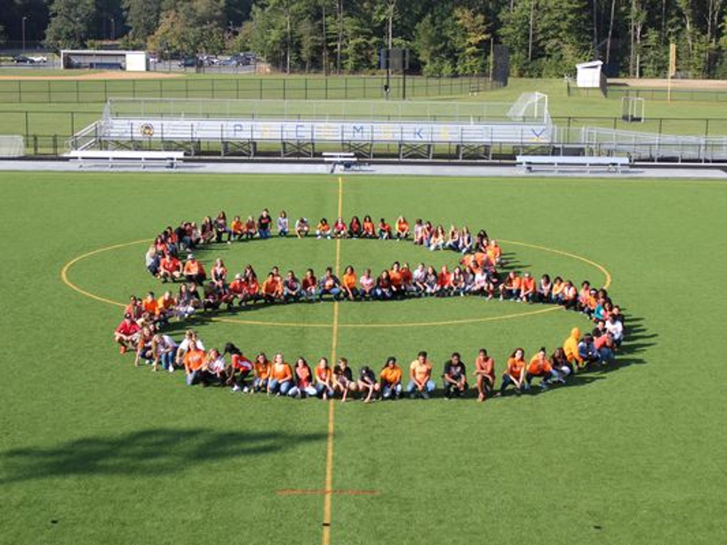 "Pocomoke High School students form Cal Ripken Jr.'s number, an ""8"", in an effort to help bring him to speak at the school's 2015 graduation ceremony."