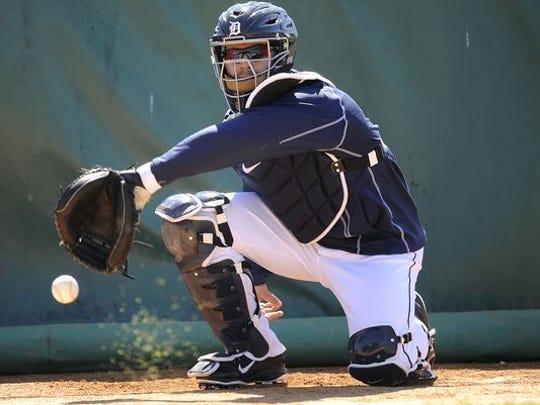 Alex Avila catches a bullpen in spring training.