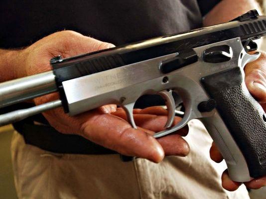635610855959839765-635537447486702582-Handguns