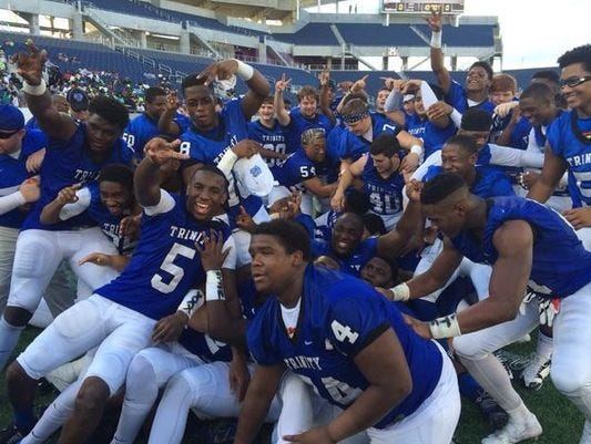 Trinity Christian players celebrate their Class 3A state title.