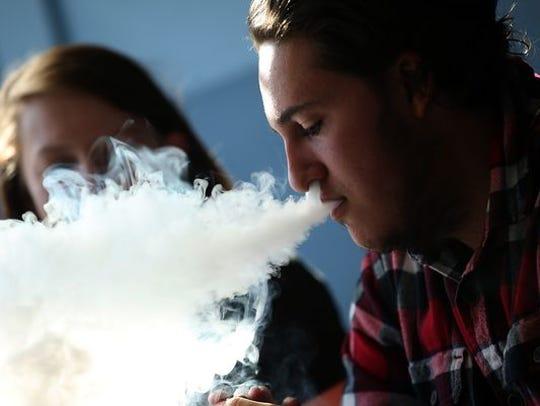 Teen smoking an e-cigarette