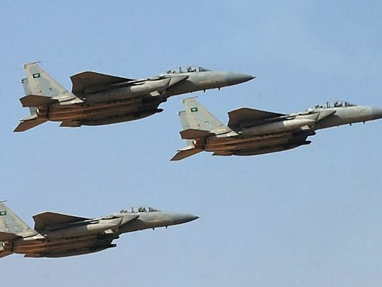 Saudi Royal Air Force jets perform Jan. 1, 2013, during a graduation ceremony at the King Faisal Air Academy at the Riyadh military airport. Saudi Arabia took the UK's spot with the third largest  defense budget in the world, analysts say.