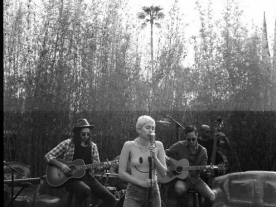 Miley Cyrus sings in her backyard to kick off the Happy Hippie Foundation.