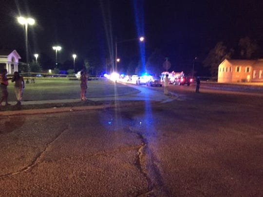 Officials work the scene where two Hattiesburg police officers were shot tonight in downtown Hattiesburg.