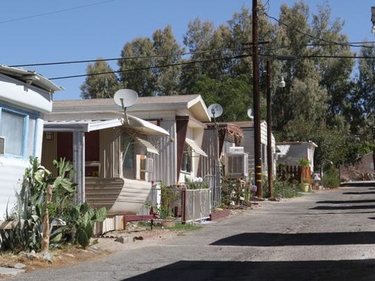 This Desert Sun file photo shows 5th Street mobile home park in Desert Hot Springs. A unit caught fire Sunday night and left two people displaced, according to Cal Fire.