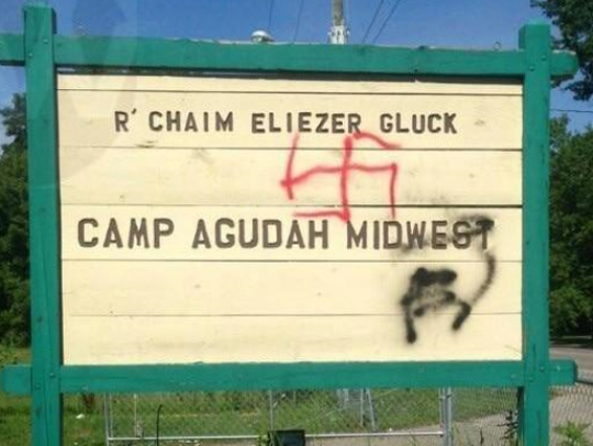 Someone spray-painted this sign with graffiti sometime